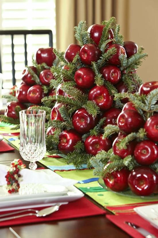 originelle tischdeko weihnachten mit äpfeln und tannengrün