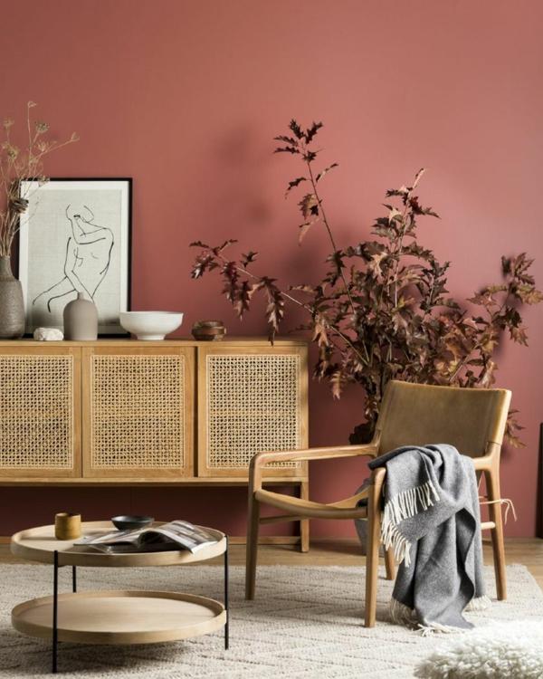 terrakotta wandfarbe antikmöbel sideboard sessel runder beistelltisch