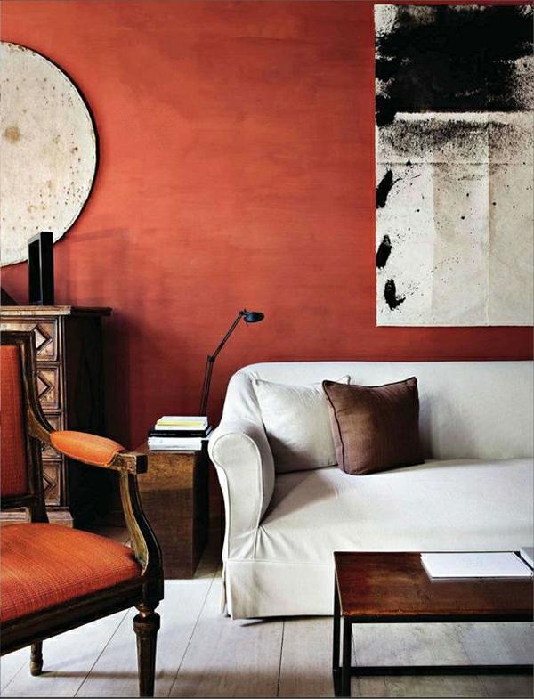 terrakotta wandfarbe ledersesel weißes sofa