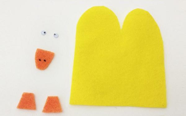 Fingerpuppen basteln Anleitung Bastelideen mit Filz gelbe Ente