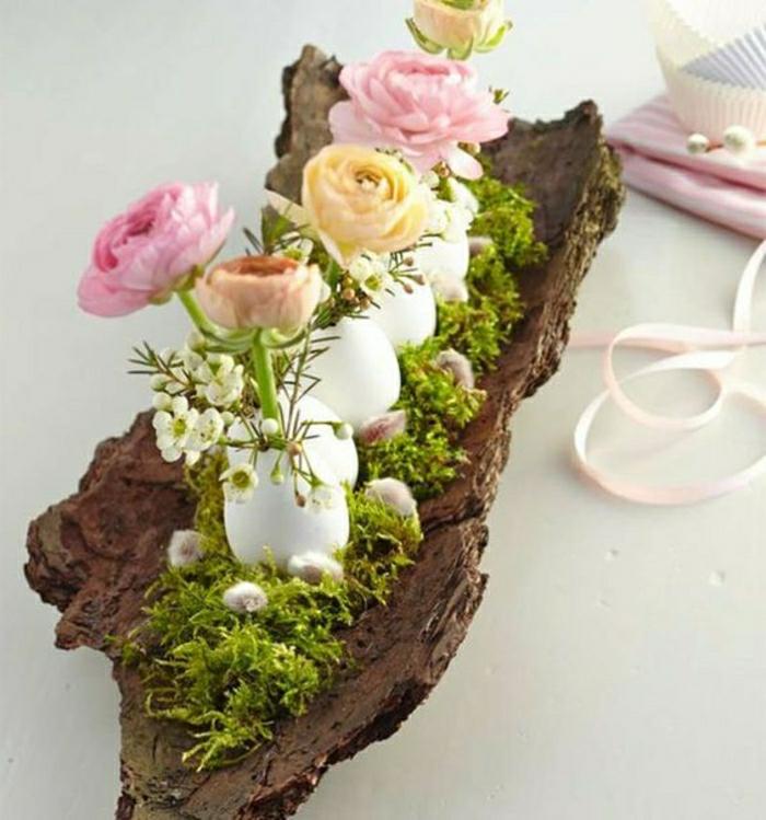 Frühlingsdeko selber machen basteln mit naturmaterialien moos ranunkel