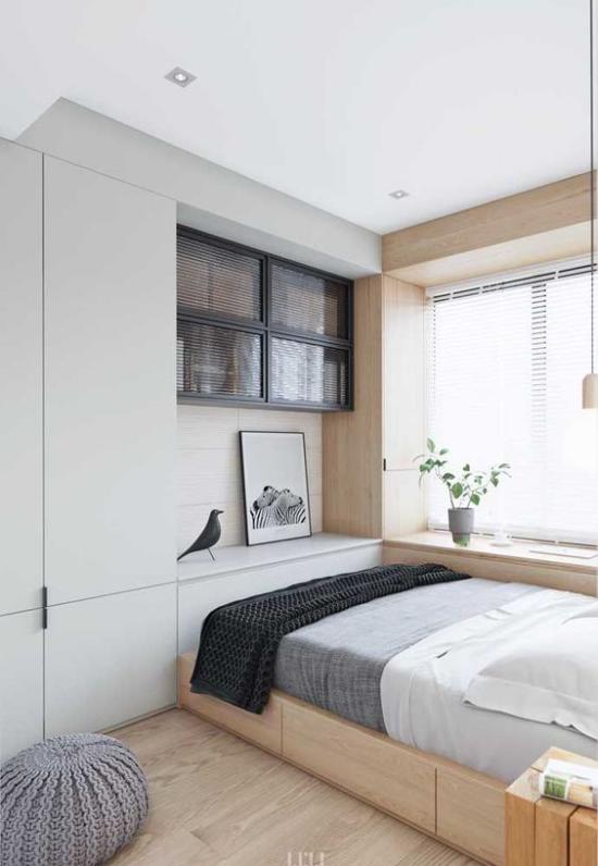 kleines Schlafzimmer optisch erweitern helles Ambiente deckenhohe eingebaute Kleiderschränke gute Staumöglichkeit Grau Weiß Anthrazit dominieren