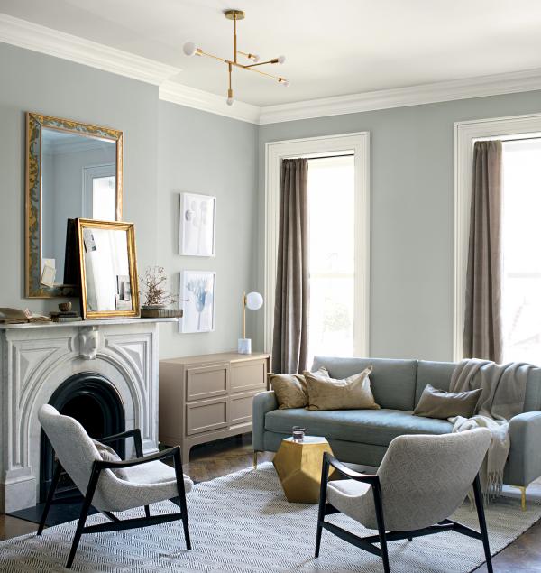 Aktuelle Wandfarben schönes Wohnzimmer einige Grautöne Beige Kamin Polstermöbel einladend wirken