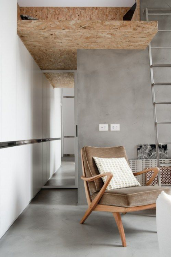 grauer Boden aus Beton minimalistischer Raum Holz Sessel
