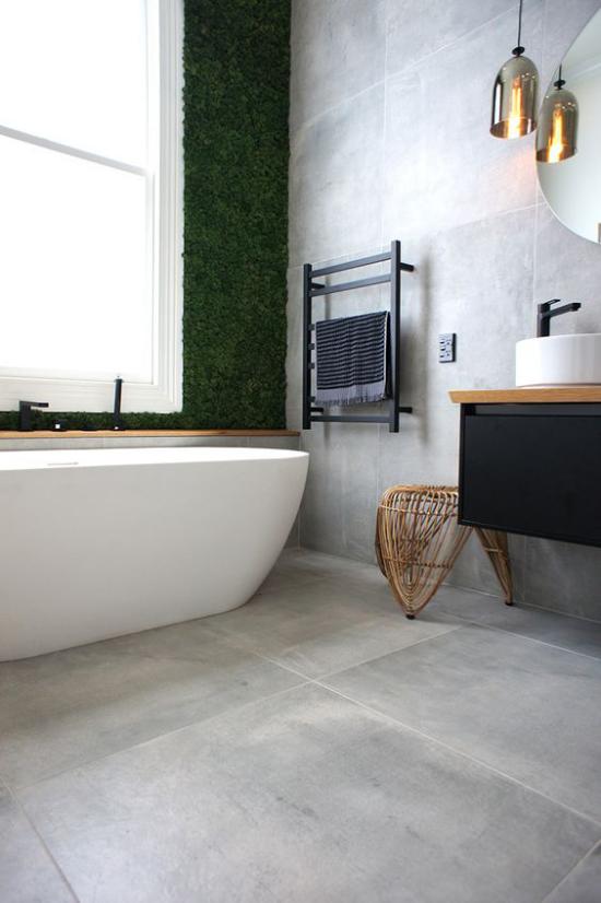 grauer Boden graue Fliesen in XXL-Format modernes minimalistisches Bad Badewanne großes Fenster graue Wandfliesen