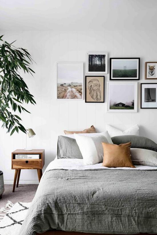 moderne Fotowand gestalten im Schlafzimmer interessante Bilder schmücken die Wand über dem Schlafbett
