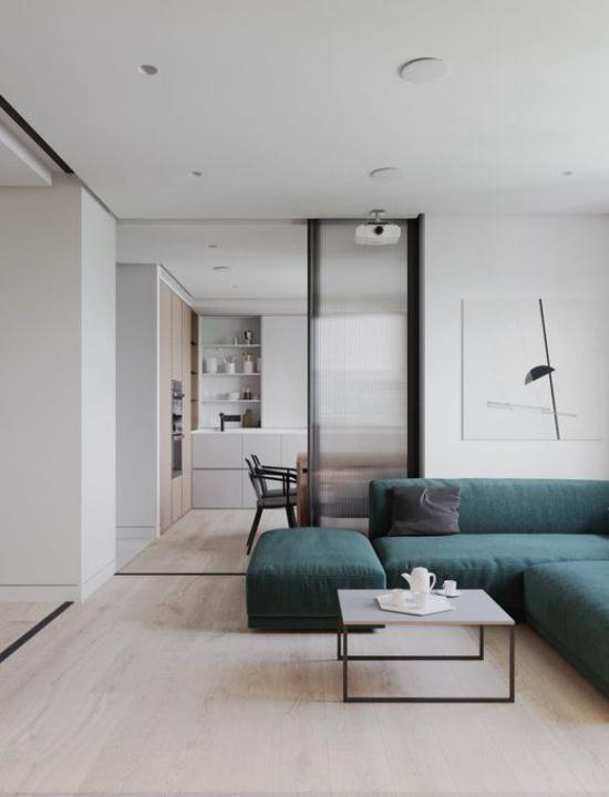 Mehr Farbe ins Interieur bringen hellgraues Wohnzimmer petrolgrünes Sofa erstklassige Idee