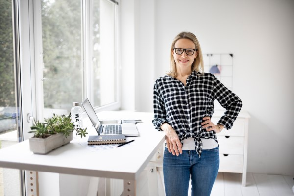 Woman,Working,At,A,Standing,Desk,In,Office