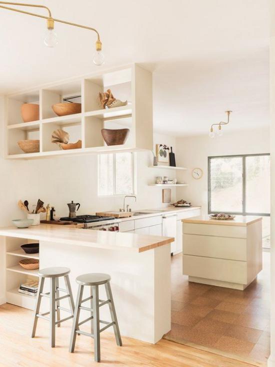 L-Küche sehr elegantes Küchendesign perfekter Entwurf Raumtrenner muntifunktionelle Kücheninsel