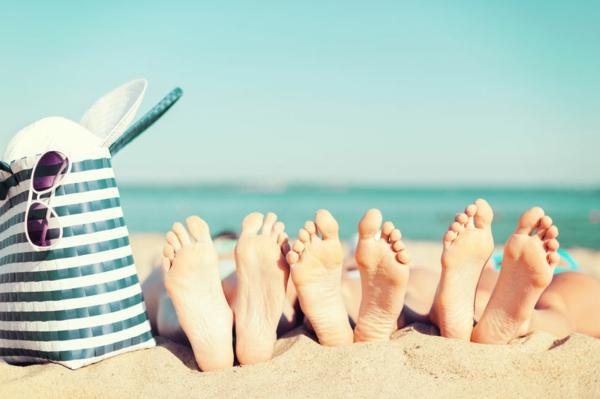 three women lying on the beach
