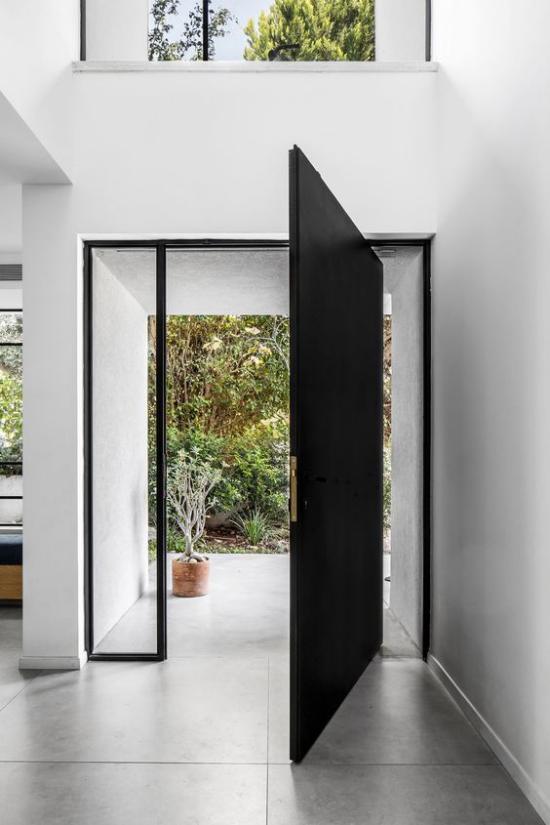 Drehtüren fürs Zuhause schickes design Modell aus schwarzem Metall und Glas am Hauseingang wetterfest
