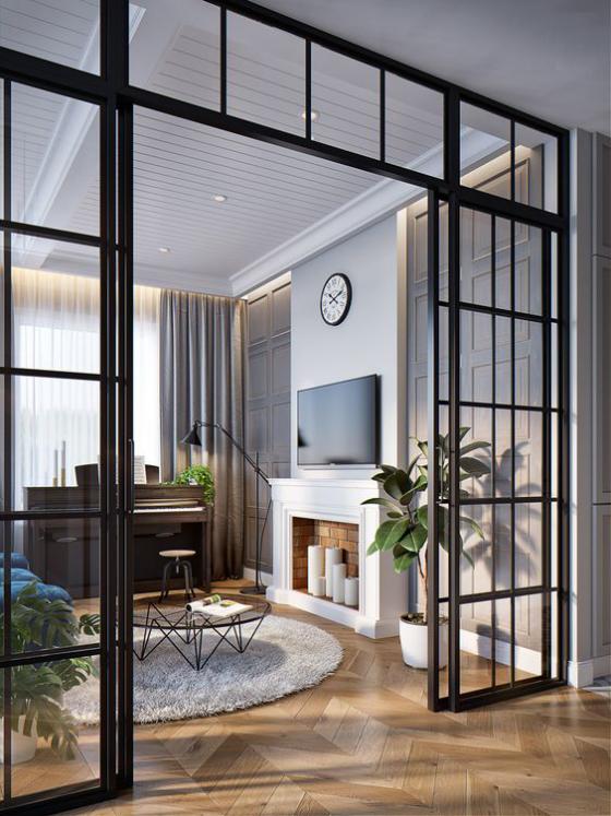 französische Fenstertüren schwarze Rahmen große Glasscheiben elegantes Design Übergang zum modernen Wohnzimmer