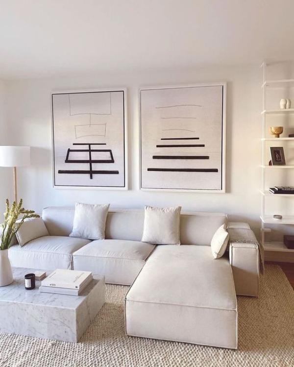 modernes Wohnzimmer Grundfarbe Weiß weißes Ecksofa