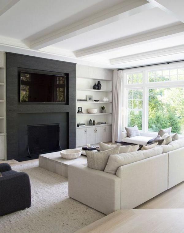 modernes Wohnzimmer Weiß und Schwarz im Kontrast gerade Linienführung schicke Möbel schwarze Wand