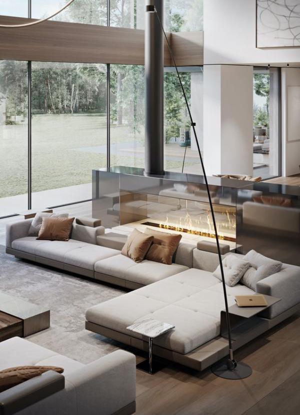 modernes Wohnzimmer auf zwei Ebenen schickes Interieur weiße sehr elegante Sitzgarnitur Bio Kamin große Fenster Bogenlampe