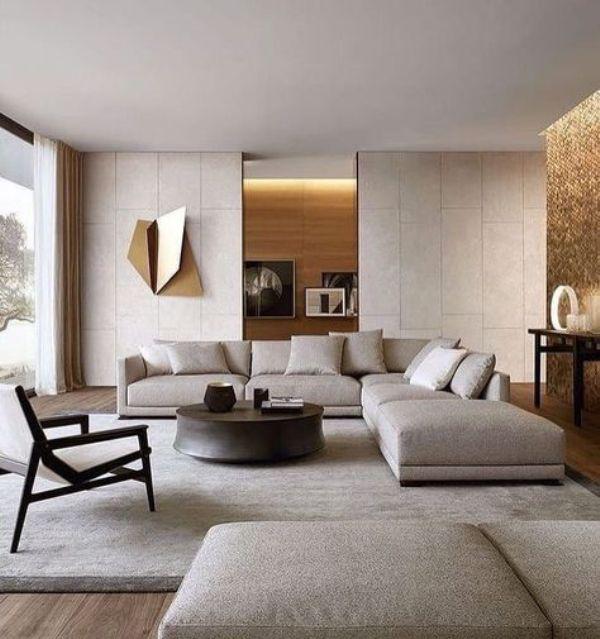 modernes Wohnzimmer sehr elegantes Ambiente weiße Sitzgarnitur Teppich eingebaute LED Beleuchtung