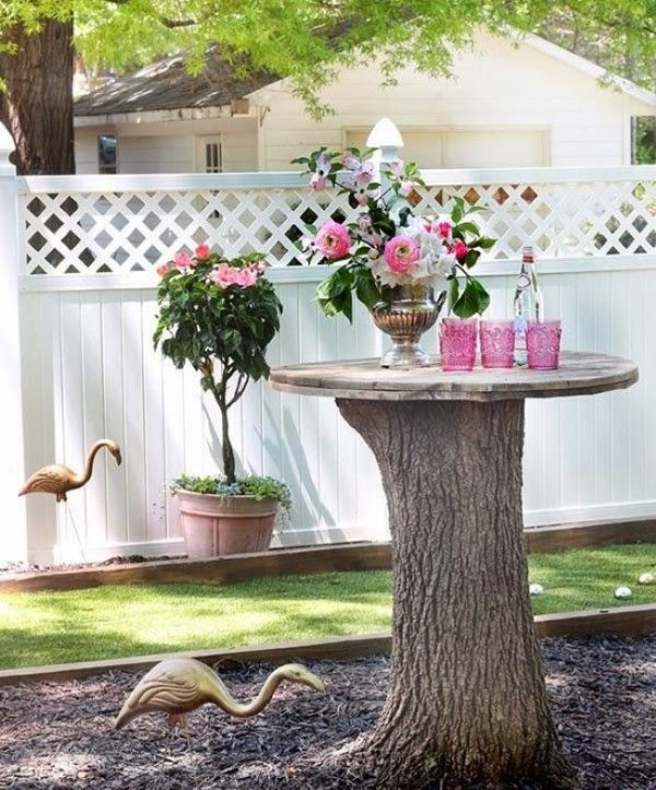 Baumstumpf dekorieren – kreative Ideen mit Liebe zur Natur gartentisch blumen deko