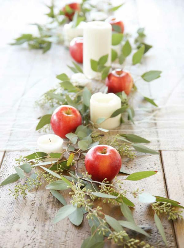 kerzen äpfel eukalyptus blätter herbstliche tischdeko