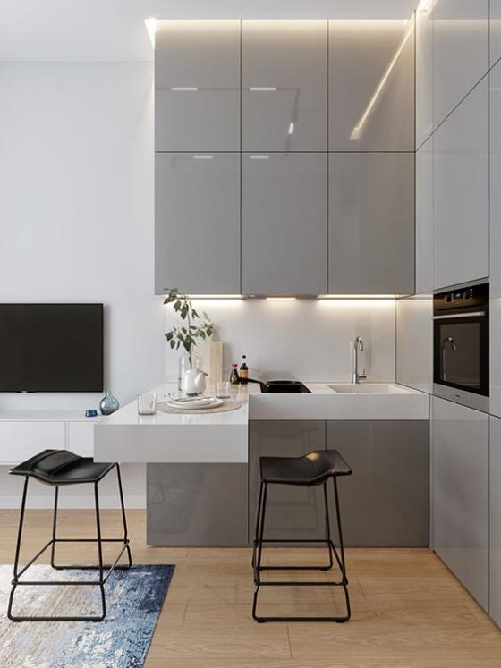 moderne Küche gerade Linienführung eifache geometrische Formen Grau Weiß Schwarz helles Holz auf dem Fußboden